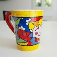 Romero Britto Ceramic Mug The hug yellow
