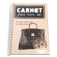 Spiral notebook about handbag by Alicia and Rafael Alonzo